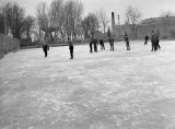 Ice skaters on tennis court, Ritzville, Washington, January 19, 1940