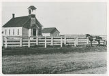Michigan Prairie / Sutton school with bell tower and enclosed porch, Adams County, Washington,...