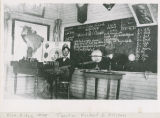 Blue Ridge School classroom interior and teacher, Adams County, Washington, circa 1908-1909