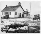 One-room schoolhouse with cars in front, Adams County, Washington, circa 1920-1929