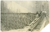 Men on railroad trestle near Rockford, Washington, ca. 1910-1929