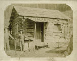 Log cabin with unidentified hunters