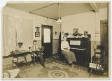 Fred and Marie Lenz in hotel parlor, Langley, Washington, circa 1916