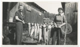 Bush Point salmon held by two ladies, Whidbey Island, Washington, 1944